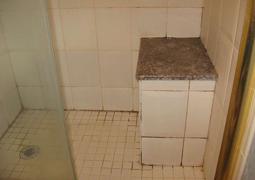 Dirty shower floor tile and grout